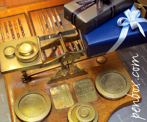 Free UK Postage at Penbox.com and brass postal scales.